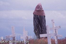 Woman standing in cemetery